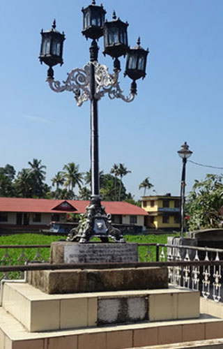 Anchuvilakku - stone lamp post in Kottayam