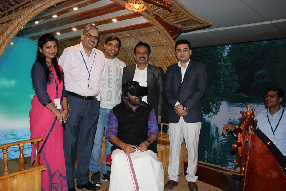 "Mr. Kadakampally Surendran, Minister for Tourism, Government of Kerala at ""The Great Backwater VR Experience""  set up by Kerala Tourism in Delhi Airport. Also seen, Mr. U. V. Jose IAS, Director Kerala Tourism."
