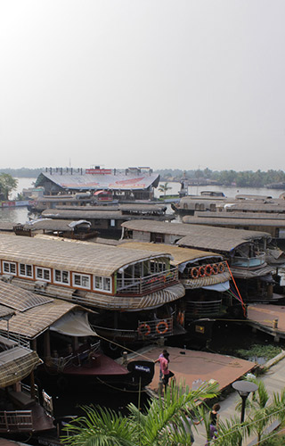 Houseboats lined-up in backwaters of Kerala