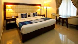 Click here to view the details of Hotel Ajantha Regency