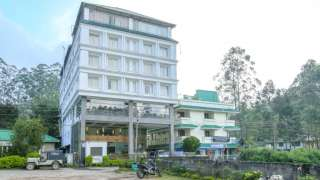 Click here to view the details of Grand Plaza Munnar