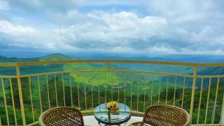 Click here to view the details of  The Cliff Resort Munnar