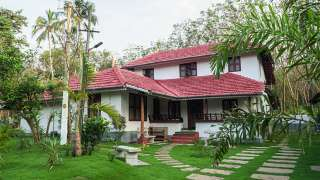 Click here to view the details of Anamala Homestays