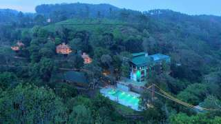 Click here to view the details of Vythiri Village Resort