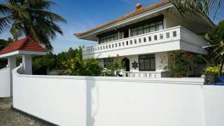 Click here to view the details of The Island House Home Stay