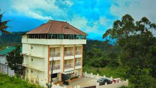 Click here to view the details of IceBerg Hill Resort Munnar
