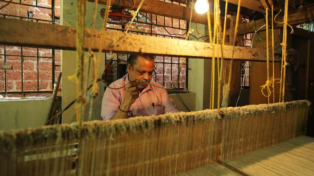 A weaver at Azhikode Handloom Village